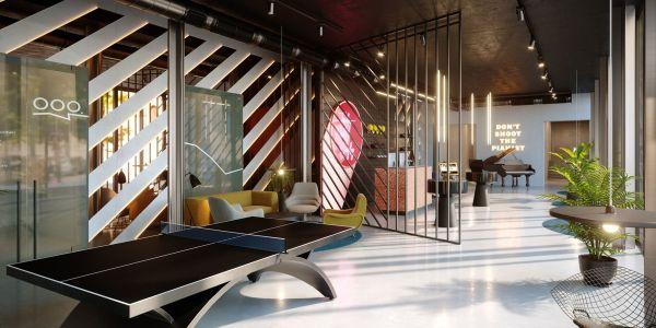 La lobby di The Student Hotel Firenze Lavagnini, con il tavolo da ping pong