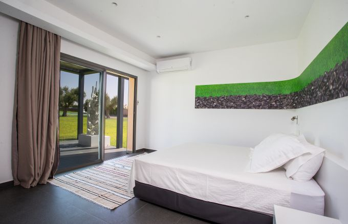 Una delle camere da letto del resort resort Les Olivades Marrakech