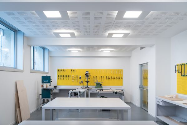 Illuminazione Linea Light Group per l'Istituto Raffles di Milano