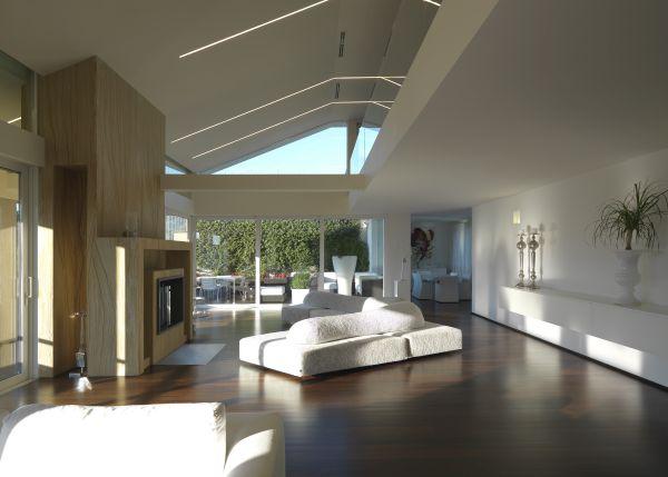 La sala del nuovo edificio residenziale affacciato sui giardini della Reggia di Caserta progetto OfCA, arch. Raffaele Cutillo