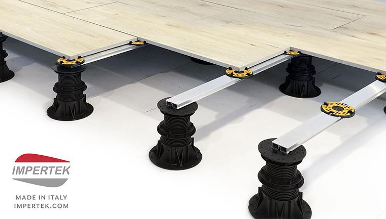 Il sistema Impertek di supporti per pavimenti misti tile e decking
