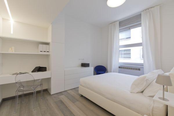 Camera da letto dell'abitazione temporary realizzata in via Dogana a Milano