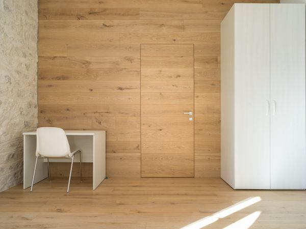 Eclisse Syntesis Line battente nelle camere della nuova Foresteria Santa Maria