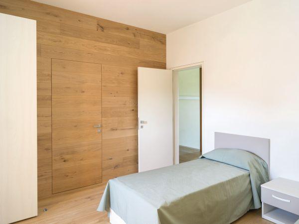 Porte a filomuro Eclisse per le camere della nuova Foresteria Santa Maria a Treviso