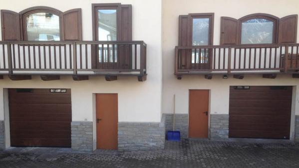 Portoni sezionali in legno