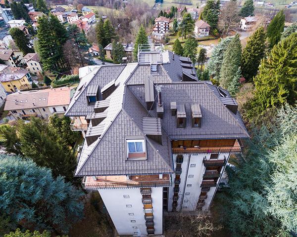 Ristrutturazione di un condominio in Valsassina con tegole Prefa