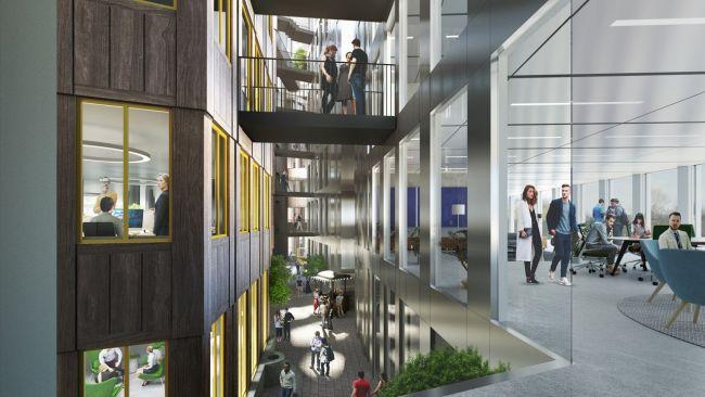 Interno edificio Tripolis Park ad Amsterdam: vetrate, ponti e scale